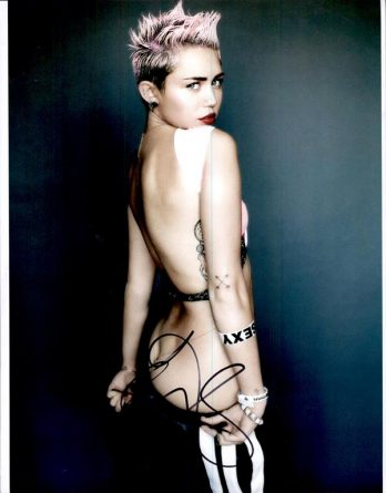Miley Cyrus authentic signed 8x10 picture